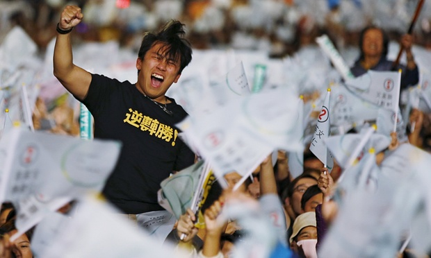 A Tsai supporter celebrates the election results. Photograph: Damir Sagolj/Reuters