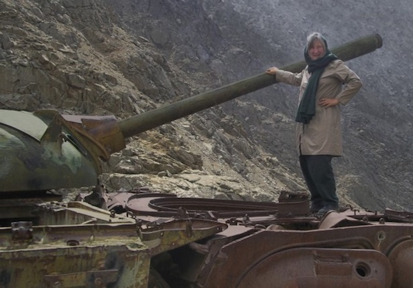 Unarmed Peacekeeper Linda Sartor with an Afghani tank.