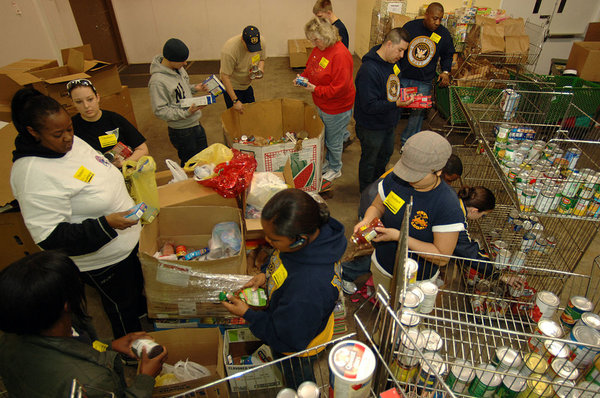 us_navy_sailors_sort_through_food_items_checking_expiration_dates_while_volunteering_at_the_food_bank_of_southeastern_virginia